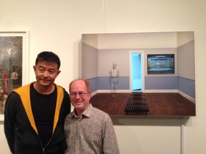 Gregory Scott stops by the booth just as Liu Bolin comes to see the piece Greg made referencing his work!