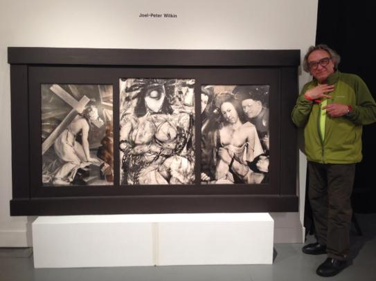 Joel-Peter Witkin standing next to his piece at Paris Photo L.A.