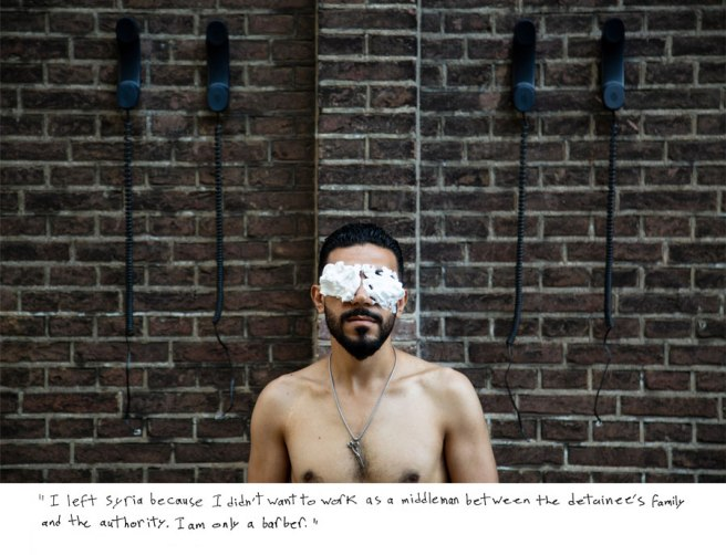 Image: Omar Imam, Untitled, 2018 [I am only a barber]. A portrait of Omar Imam in front of a brick wall. He is shirtless with shaving cream covering his eyes.