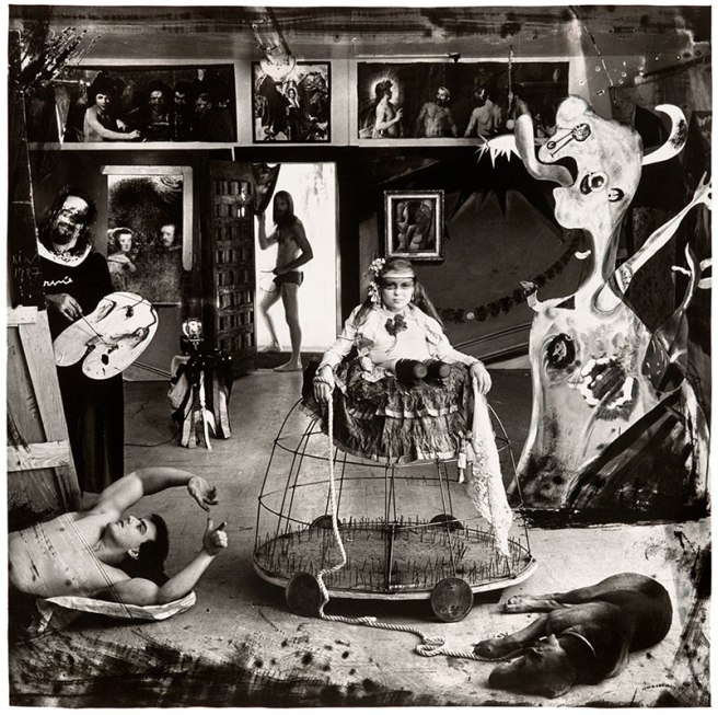 Image: Las Meninas, New Mexico, 1987 by Joel-Peter Witkin. A black and white photograph with a multitude of surreal figures. At center, a woman with a partial leg sits atop a cage-like structure on wheels with a sleeping dog at the bottom right. On the left, a bare-chested man lies on the floor, modeling for a painter holding his palette. In the background, a man exits out an open door. Art historical and religious references fill the room.