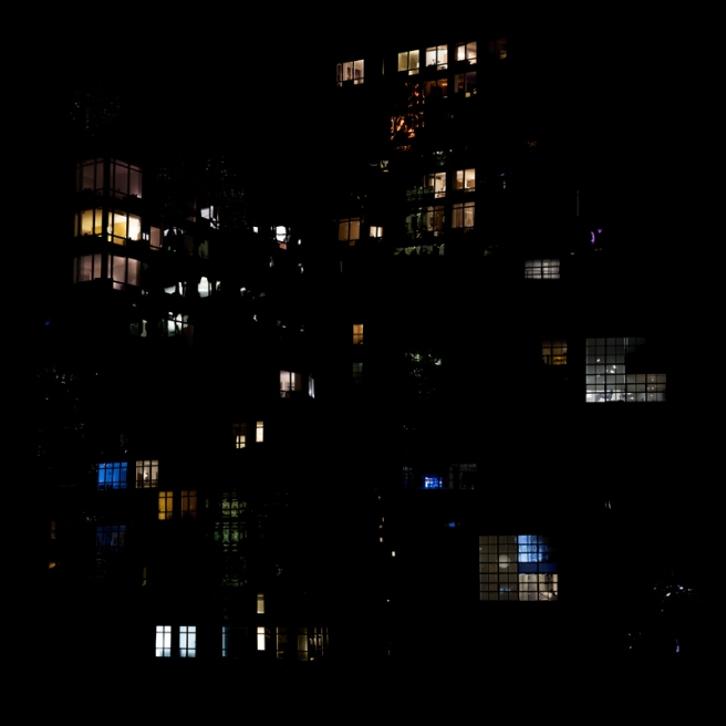 Image: Clarissa Bonet, SL.2016.0610 NYC, 2016. The photo is predominantly black, with different colored light radiating from windows.