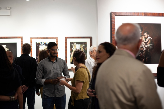 "Image: A crowd at the opening of the exhibition ""Sandro Miller: I am Papua New Guinea"""