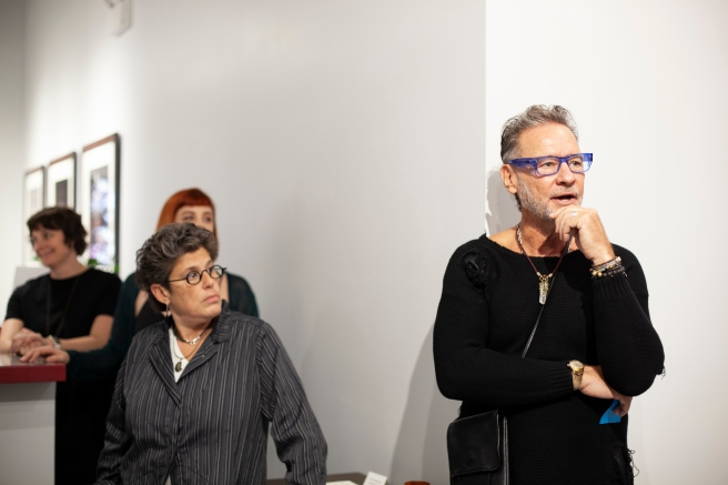 Image: Sandro Miller stands next to Catherine Edelman while talking about his artwork.
