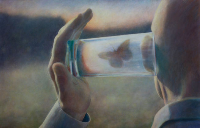 Image: Robert & Shana ParkeHarrison, Cadence, 2019. A man presses a glass cup containing an orange butterfly up to his ear.