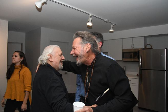 Image: Sandro Miller hugging a friend at Catherine Edelman Gallery.