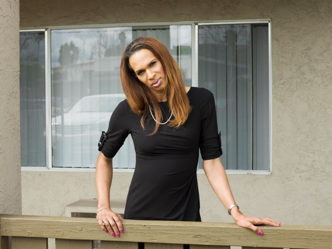 Image: Jess T. Dugan, Cassandra, 50, San Diego, CA, 2017. A portrait of a person wearing a black dress.
